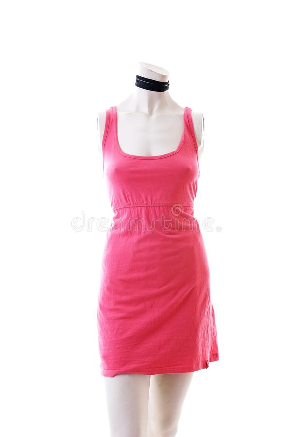 Pink dress long top mini dress on mannequin full body shop display. Woman fashion styles, clothes on white studio background. royalty free stock images