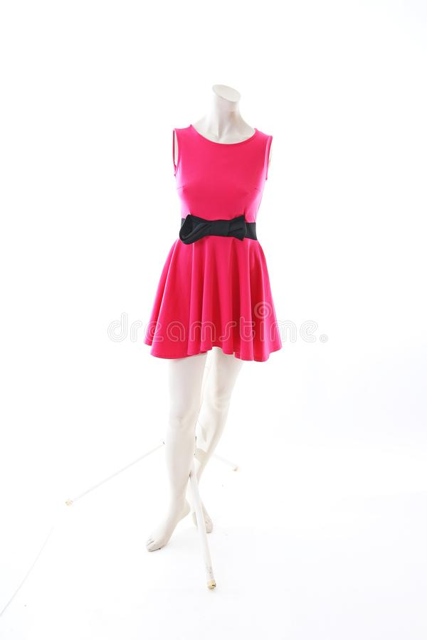 Pink dress long top mini dress on mannequin full body shop display. Woman fashion styles, clothes on white studio background. royalty free stock photos
