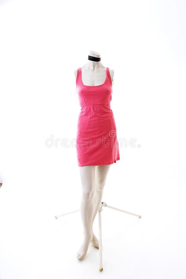 Pink dress long top mini dress on mannequin full body shop display. Woman fashion styles, clothes on white studio background. stock image