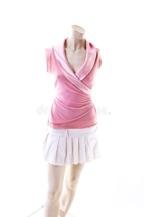 Pink dress long top mini dress on mannequin full body shop display. Woman fashion styles, clothes on white studio background. royalty free stock photography