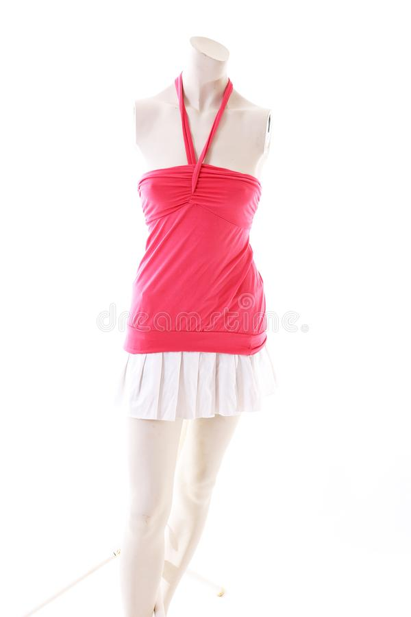 Pink dress long top mini dress on mannequin full body shop display. Woman fashion styles, clothes on white studio background. stock photography