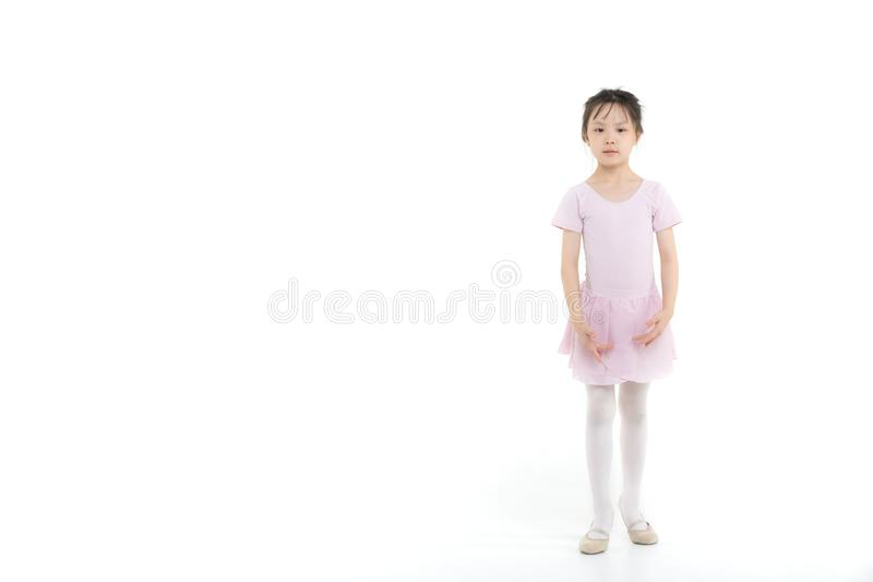 Pink dressed Asian girl in a ballet pose royalty free stock image