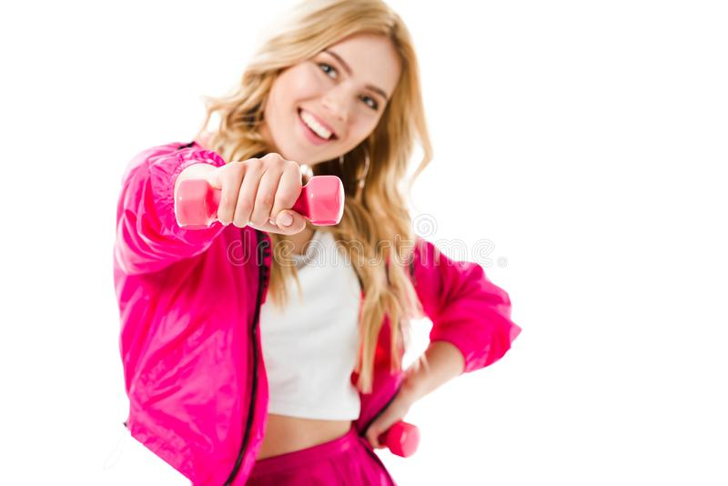 Pink dumbbells in hands of blonde woman royalty free stock photos