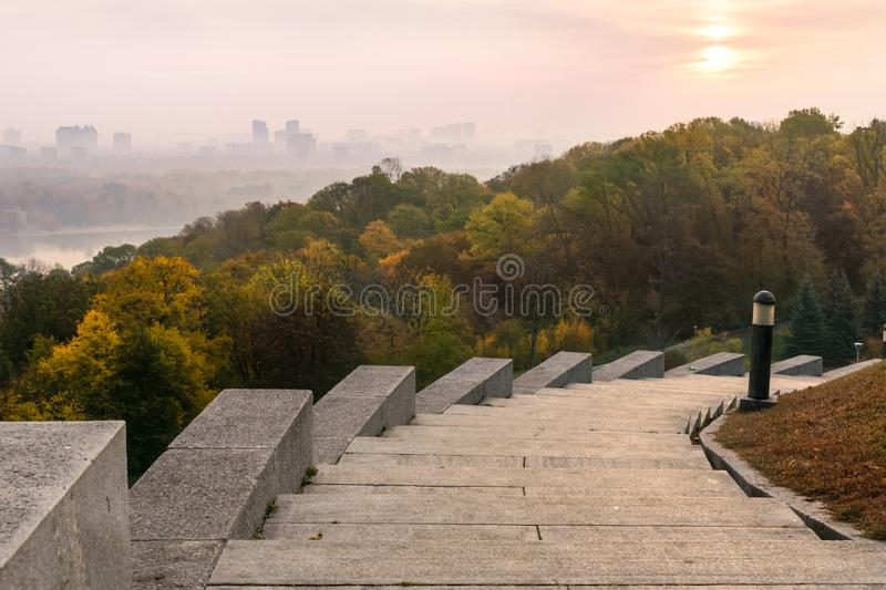 Pink Early morning, fog in the city, Stairs. Pink dawn over the river in the metropolis. Cityscape Kiev, Ukraine, Europe royalty free stock photos