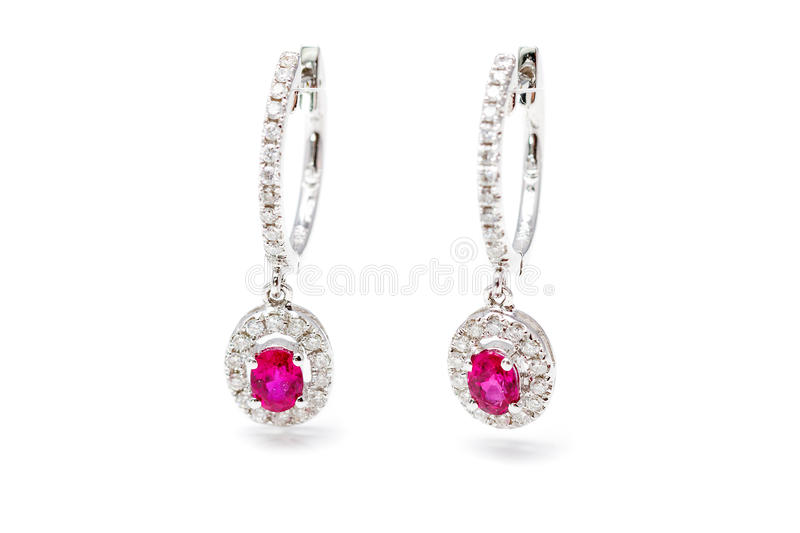 Pink earrings. With gold earrings with pink stones and diamonds royalty free stock photo