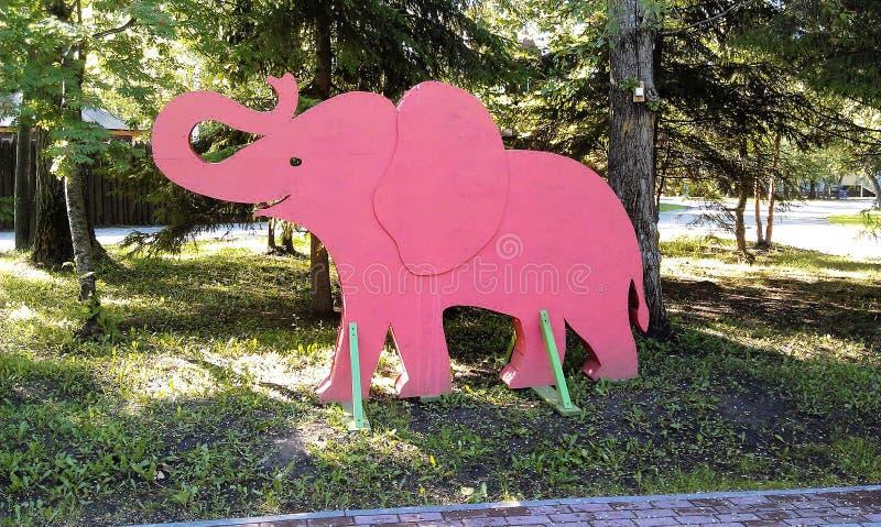 Pink elephant in city garden stock photos