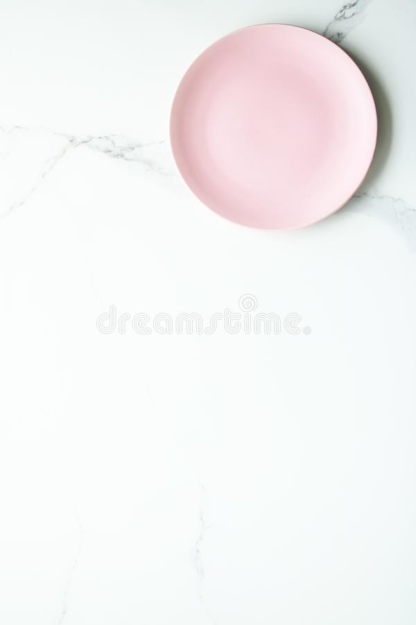 Serve the perfect plate. Pink empty plate on marble, flatlay - stylish tableware, table decor and food menu concept. Serve the perfect dish stock photos