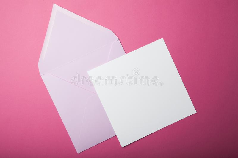 Pink envelope and blank sheet of paper, layout, mock-up stock images
