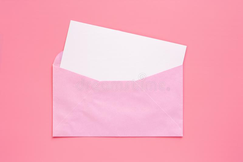 Pink envelope with blank white greeting paper card royalty free stock photography
