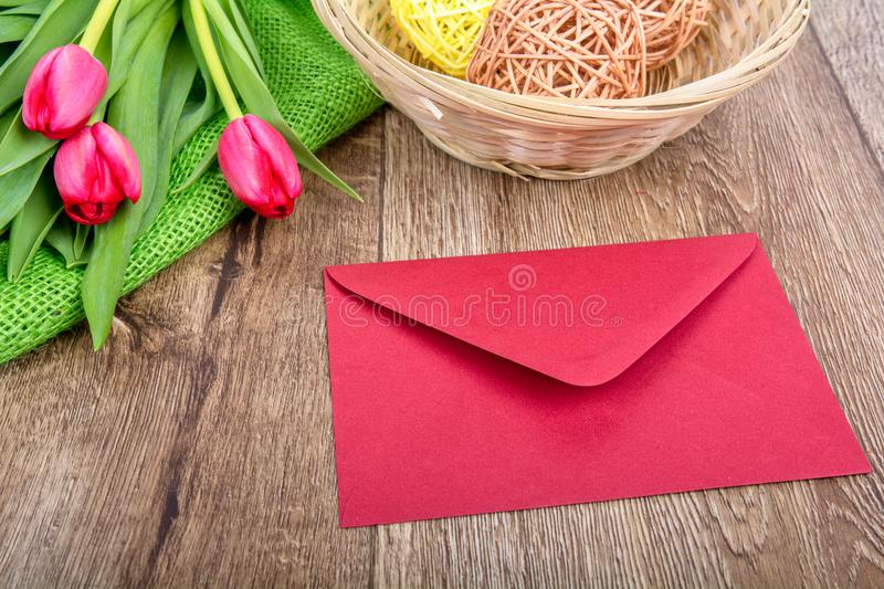 Pink envelope with tulips on a table stock photos