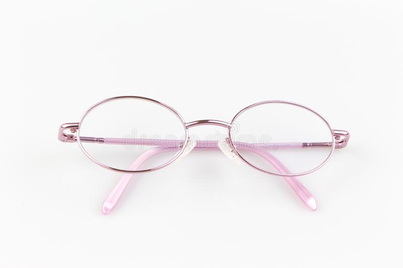 Pink eye glasses spectacles on white background. for reading daily life to a person with visual impairment stock images