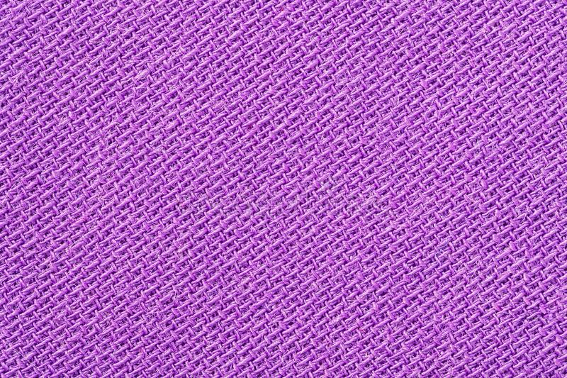 Pink fabric background texture. Detail of textile material close-up stock photography
