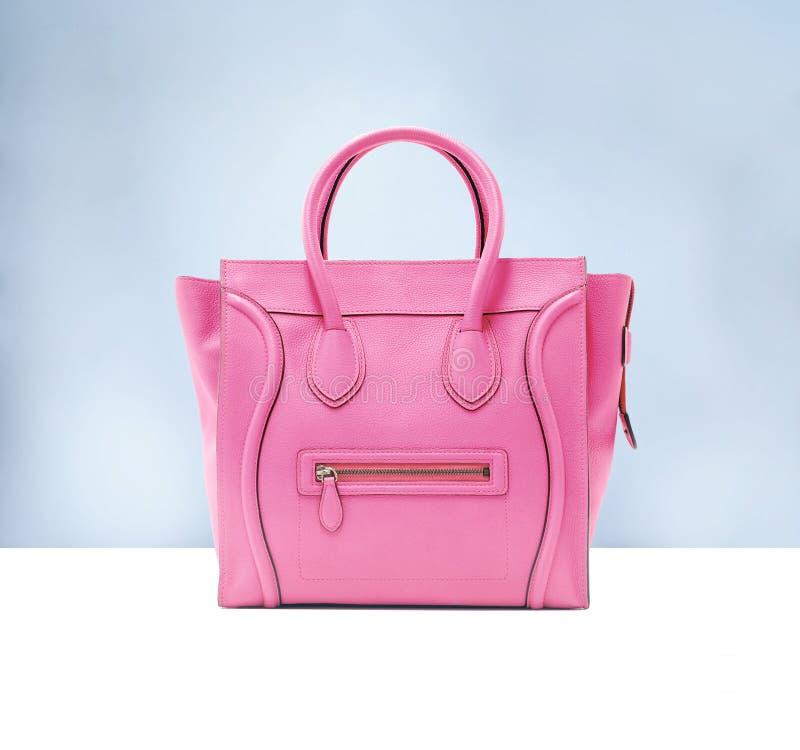 Pink fashion bag. On blue background stock images