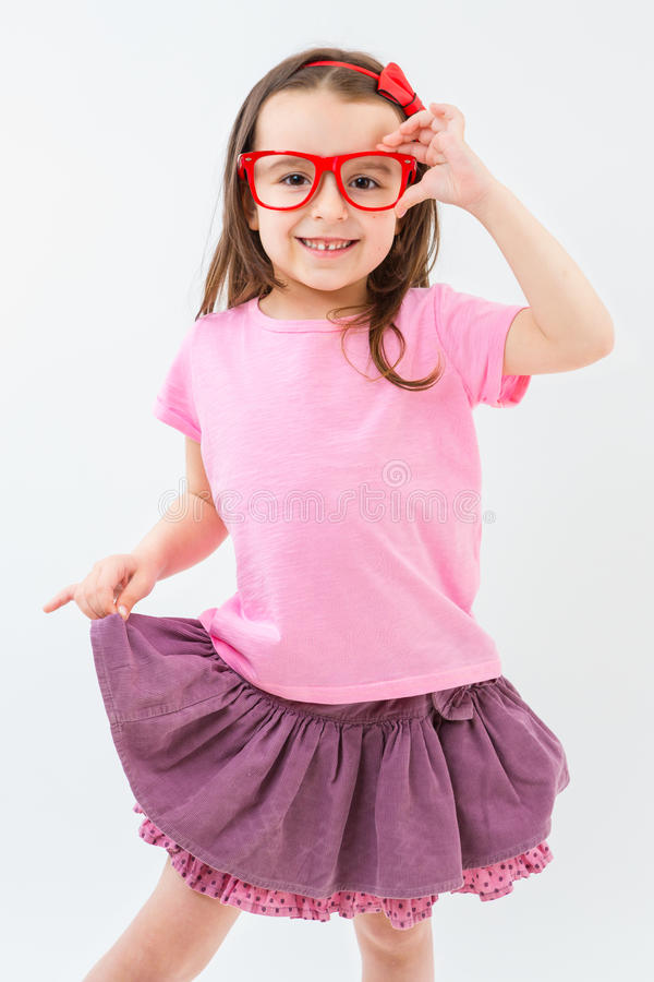 Pink fashionista hand holding red glasses. royalty free stock photo