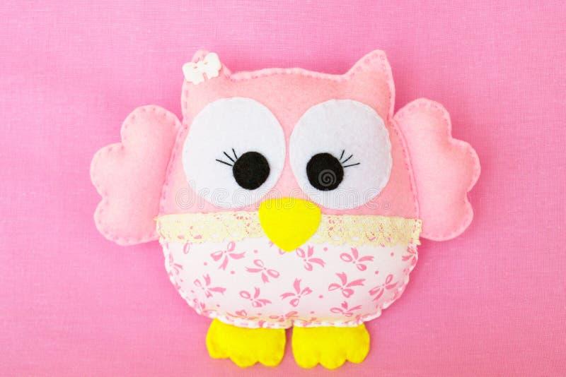 Pink felt owl, children& x27;s toy. Felt toy. Felt children& x27;s toy. Soft baby toy photo. Soft toy. Felt soft toy idea. Handmade toy. Needlework toy. Toy stock images