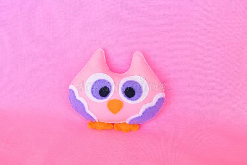 Pink felt owl, children& x27;s toy. Felt toy. Felt children& x27;s toy. Soft baby toy photo. Soft toy. Felt soft toy idea. Handmade toy. Needlework toy. Toy royalty free stock images
