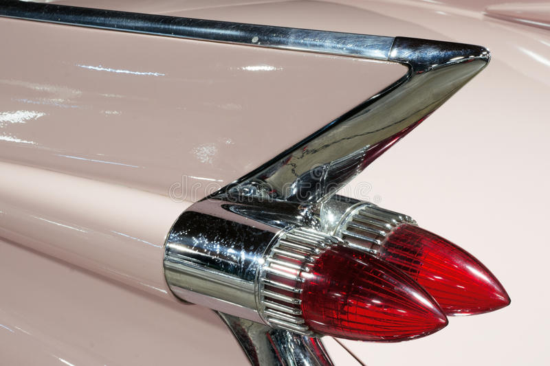 Pink Fins. Classic car in 1950`s pink complete with chrome fins royalty free stock photography