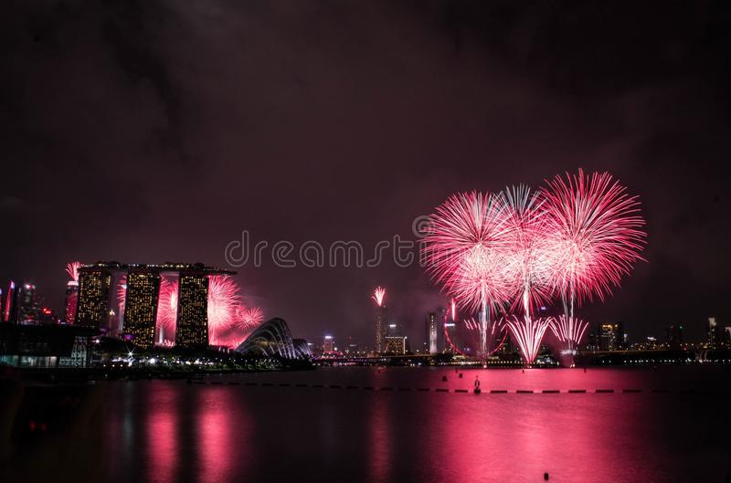 Pink Fireworks Near Reflects On Water During Night Time Free Public Domain Cc0 Image