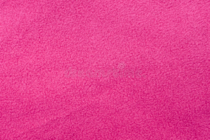 Pink fleece. A background of pink soft fleece material royalty free stock photography