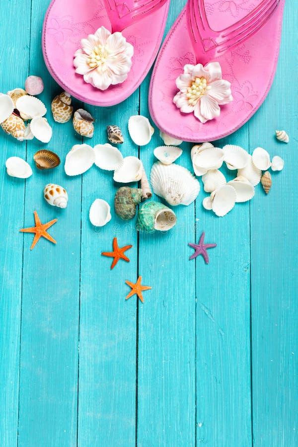 Pink flip flops and seashells royalty free stock photo