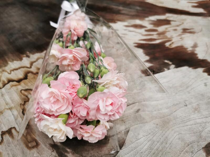 pink flower bouquet on wet wood royalty free stock image