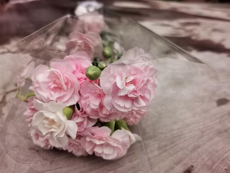 pink flower bouquet on wood table stock photography