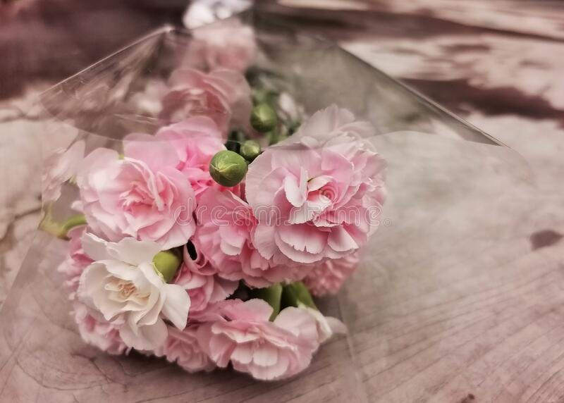 pink flower bouquet on wooden background stock photography