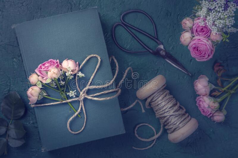 Pink flowers and the old book royalty free stock photo