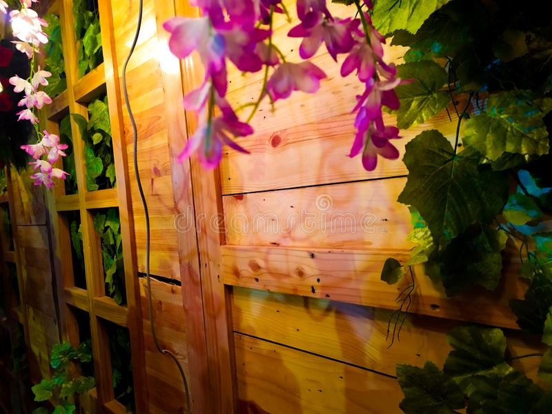 Pink flowers and wooden walls stock photos