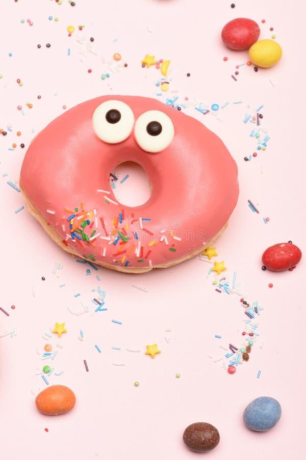 Pink funny glazed donut on white background royalty free stock image