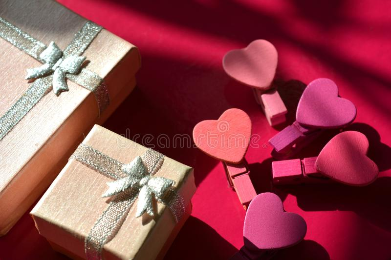Pink gift box and decorative hearts pink background royalty free stock images