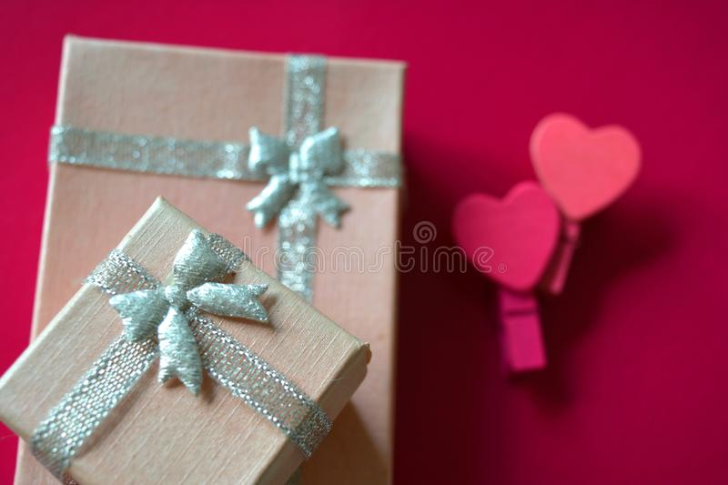 Pink gift box  and decorative hearts pink background royalty free stock photography