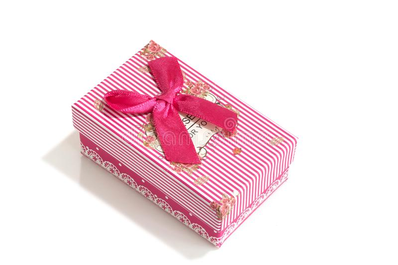 Pink gift box with ribbon bow. Holiday present. Object isolated on white background. Close-up stock image
