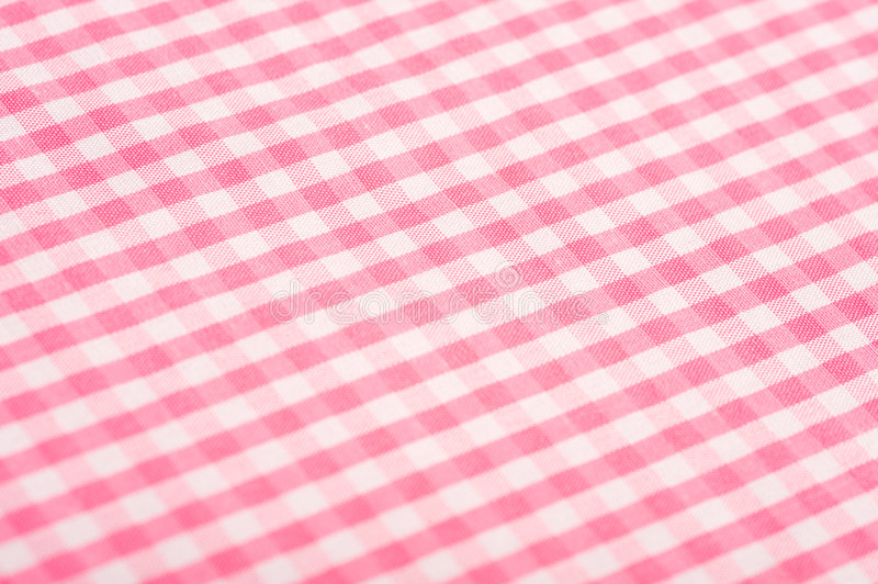 Pink Gingham Background. Gingham or checked tablecloth background royalty free stock photos