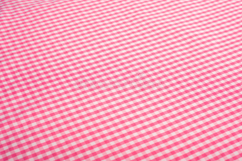 Pink Gingham Background. Gingham or checked tablecloth background royalty free stock image