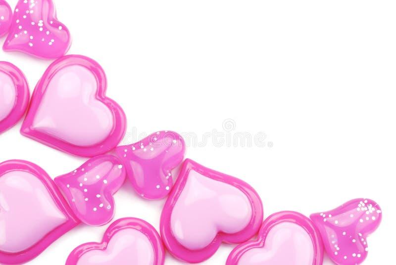 pink glansiga hjärtor för bakgrund white fotografering för bildbyråer