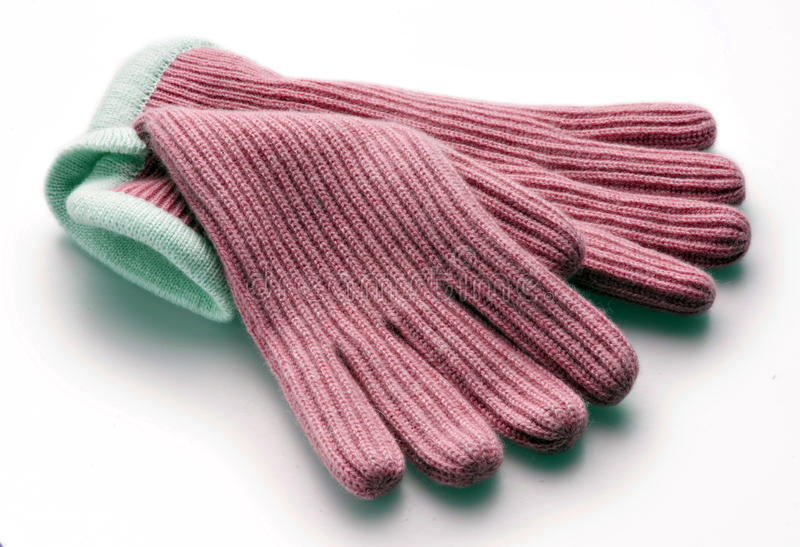 Pink gloves. Pink woolen gloves on white royalty free stock image