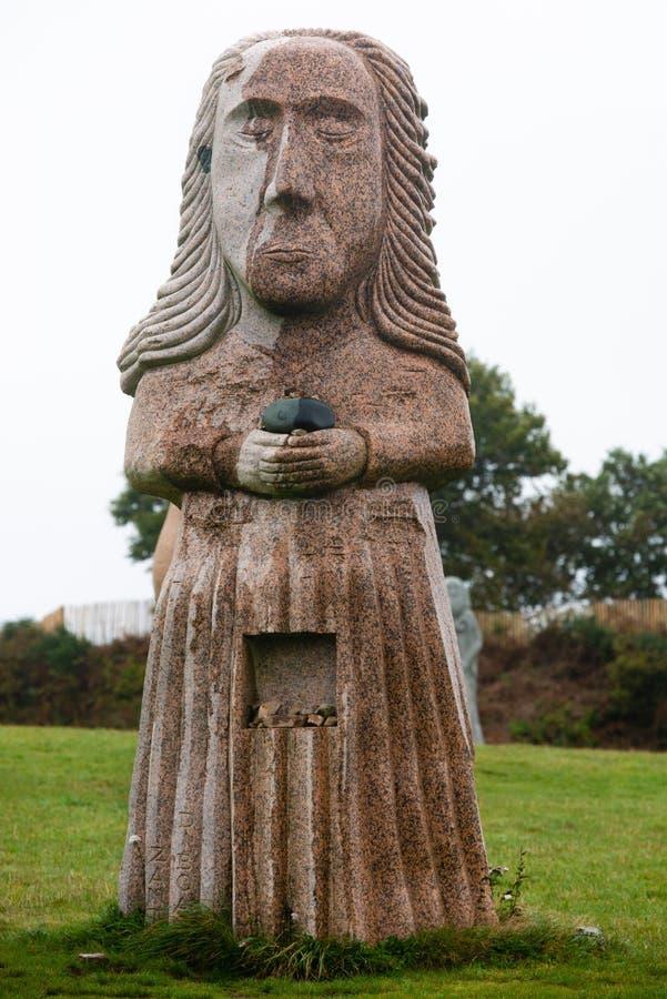 Pink granit statue of Saint Diboan royalty free stock images