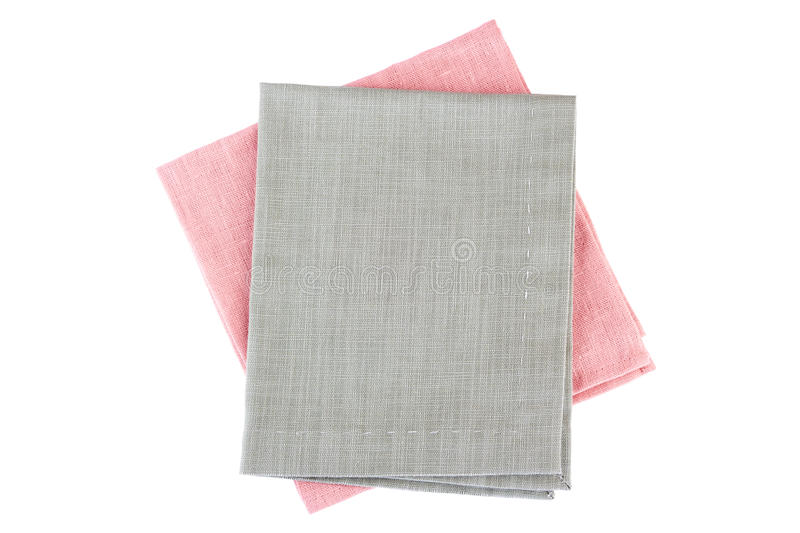 Pink and gray textile napkins on white stock images