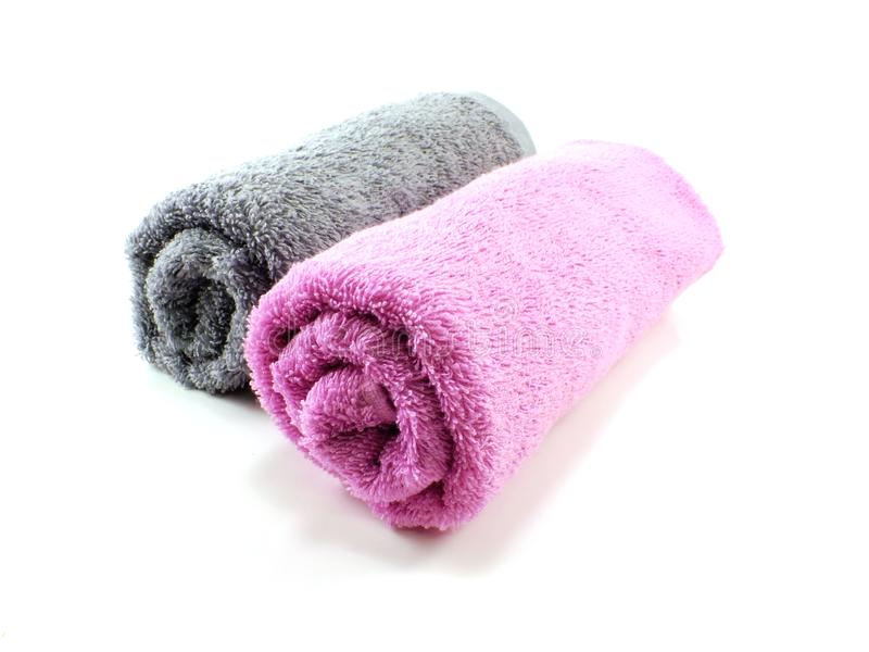 Pink and gray towel towel on the background. Pink and gray towel towel isolated on background royalty free stock photo