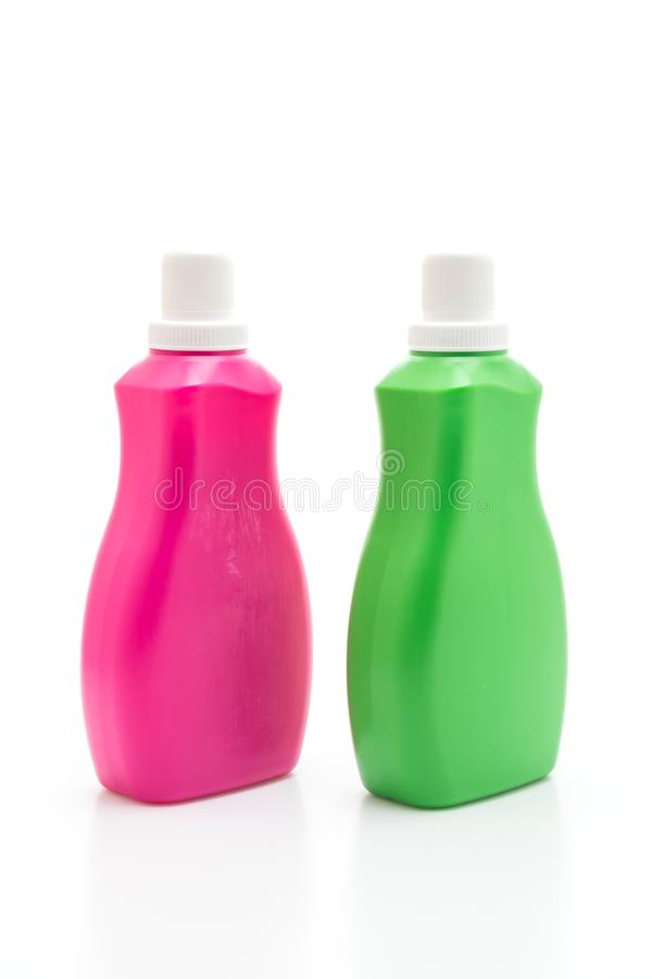 pink and green plastic bottle for detergent or floor liquid cleaning on white background stock photography