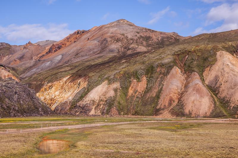 Pink and green rhyolite mountains surround the valley royalty free stock photography