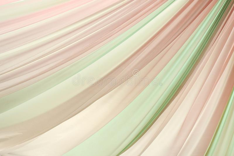 Pink and green wavy silk fabric texture background royalty free stock photos