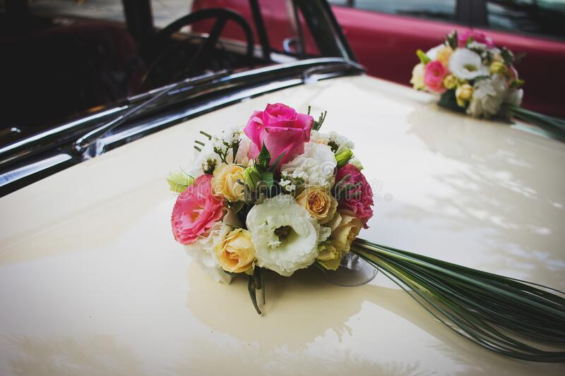 Pink Green and White Flower Bouquet on Beige Car stock photos