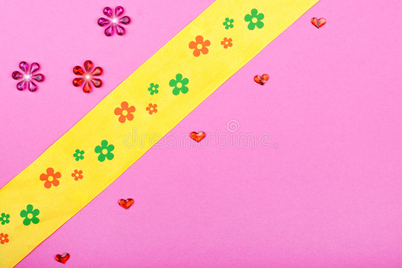 Pink greeting card with hearts and flowers. Background with stars hearts and ribbon stock image