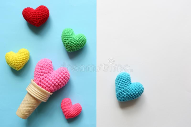 Pink handmade crochet heart in waffle cup on colorful background for valentines day royalty free stock images