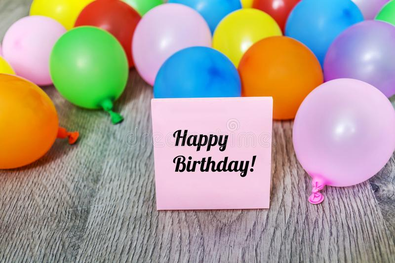 Pink Happy Birthday Card with Balloons. Pink Happy Birthday Card with Colorful Balloon Frame on a Wooden Background stock photos