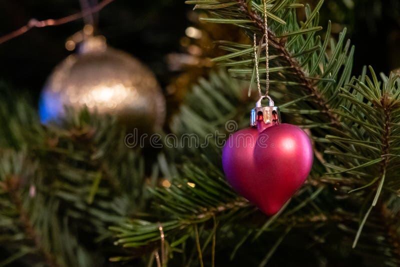Heart Shaped Xmas Decorations On Christmas Tree Stock