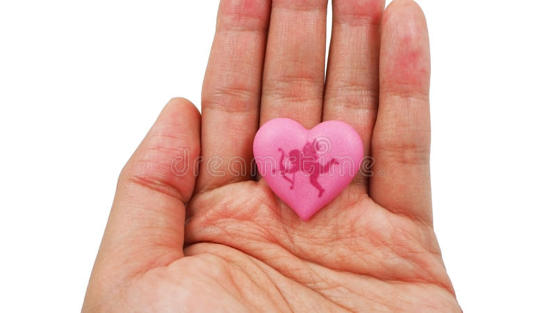 Pink heart with Cupid on woman's hand isolated on white background. Love and Valentines day concept royalty free stock photography