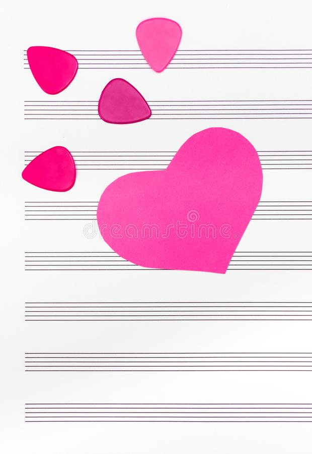 Pink heart and guitar picks on empty sheet music paper vector illustration